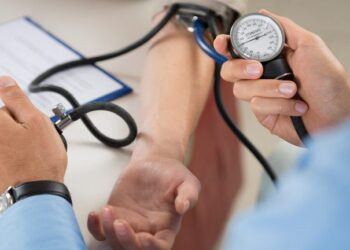 Close Up Of A Doctor Checking Blood Pressure Of A Patient